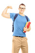 Smiling muscular student with backpack holding books