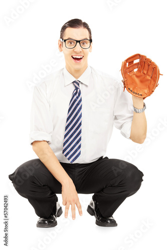 Smiling young man prepared to receive a baseball ball