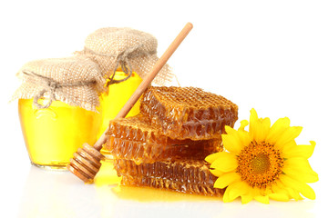 sweet honeycombs, jars with honey, wooden drizzler and