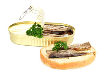 Open tin can with sardines and tasty sandwich, isolated on