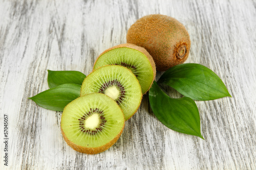 Ripe kiwi on wooden table close-up