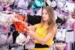 Two beautiful young woman in shop with underwear