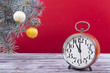 Christmas balls with an alarm clock and fir branches