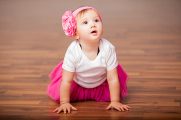 Cute baby girl dressed as ballerina