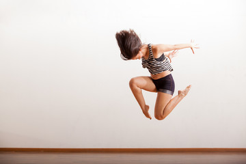 Jazz dancer performing a jump
