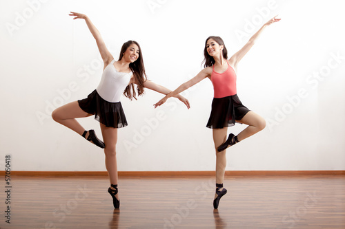Happy ballet dancers in a studio