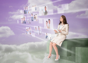 Cheerful businesswoman using futuristic interface