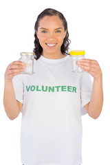 Volunteer woman showing two jars