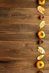 Persimmons,fall leaves and pinecones