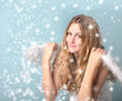 Happy female angel with snow