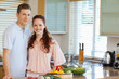 Couple standing behind kitchen counter