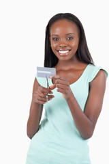 Happy smiling young woman destroying credit card