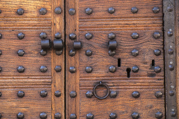 Old door with decorative nails.