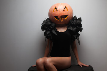 Fashionable halloweens model sitting