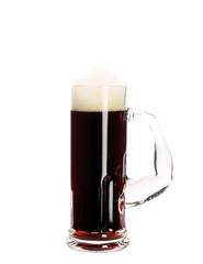 Narrow mug with brown beer.