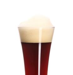 Closeup of brown beer in glass.