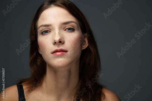 Modeling Portrait of Young Brunette with Glare Sight