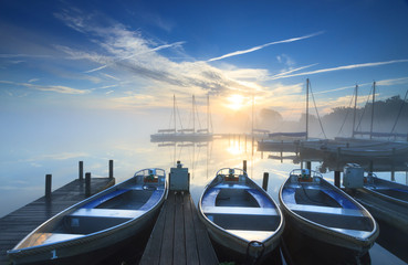 Foggy sunrise at a small harbor.