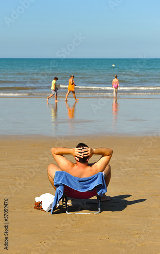 Man relaxing on the beach holiday
