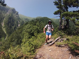 Man trail running on moutain track