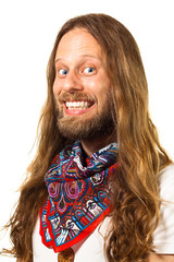 Close up portrait of a very happy hippie man isolated on white.