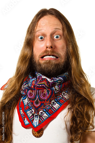 Close up of a man with a crazy expression isolated on white