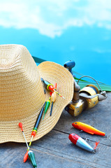Cowboy hat, fishing floats, fishing tackle  in the nature