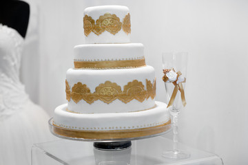Beautiful wedding cake with golden ornaments