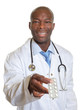 African doctor showing pills