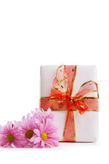 Gift box with red ribbon and pink dasies