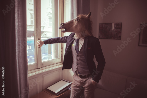 horse mask man in front of window