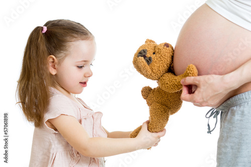 Kid girl and pregnant mother's stomach