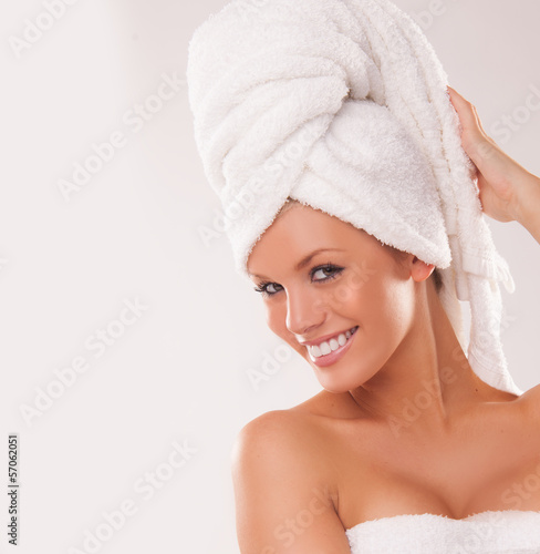 Beautiful woman with her hair in a towel