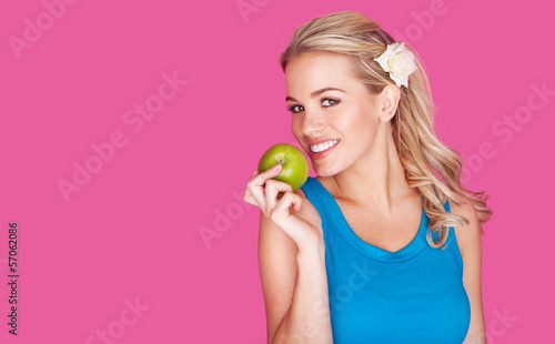 Beautiful healthy young woman with an apple