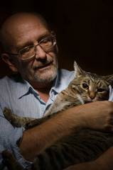 Mature man with his cat