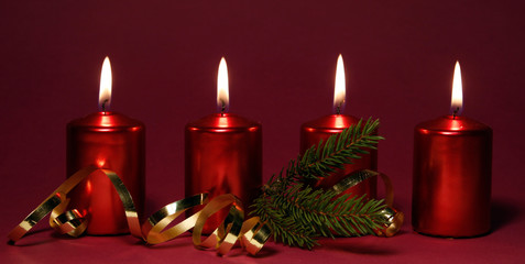 Four burning red candles