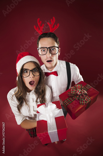 Surprise nerd couple holding christmas gifts
