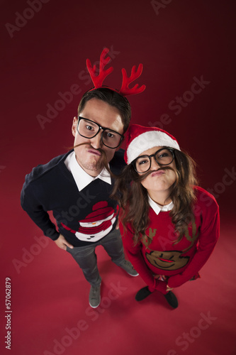 Nerd couple have fun with fake mustache