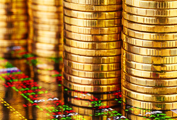 Stacks of golden coins and financial chart. Selective focus