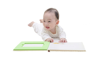 Cute baby reading a book on white background