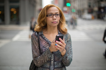 Latin Hispanic Asian woman texting cellphone