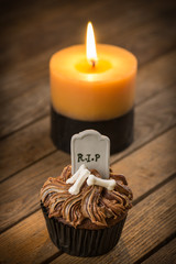 Halloween cupcake and candle with dark vignetting effect