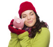 Pleased Mixed Race Woman Hugging Piggybank Isolated on White