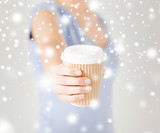 woman hand holding take away coffee cup