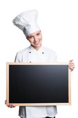 junge blonde Köchin mit Werbetafel