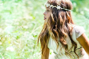 Cute girl wearing headband in field.