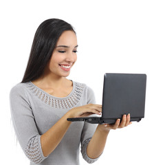 Beautiful woman browsing internet on a notebook computer