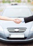 customer and salesman shaking hands