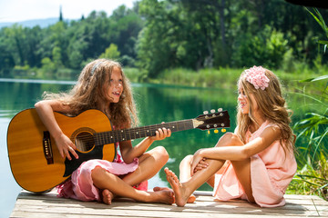 Girlfriends singing together at lake.