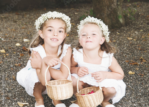 Two little girls dressed for a wedding